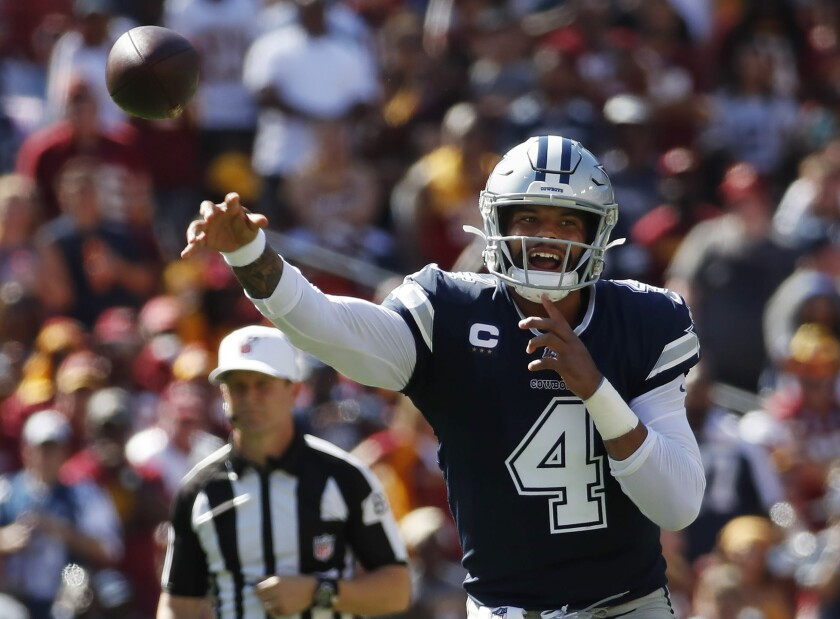 Dallas Cowboys quarterback Dak Prescott (4) passes downfield during the second half of an NFL football game, Sunday, Sept. 15, 2019, in Landover, Md. (AP Photo/Alex Brandon)
