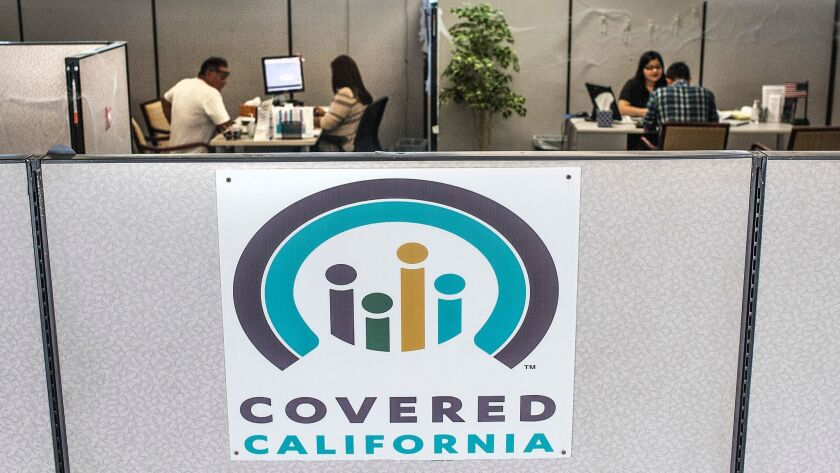 Insurance agents help sign people up for insurance through a Covered California exchange in Huntington Beach last year. Open enrollment for 2018 coverage begins Nov. 1 and runs through Jan. 31.