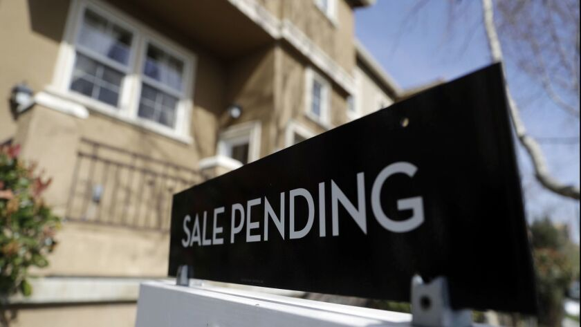 A sign advertises the pending sale of a home in San Jose.