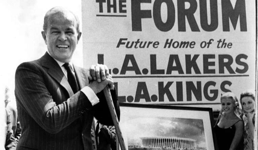 Jack Kent Cooke, owner of the Lakers and Kings, stands with a shovel in hand at the ground breaking for The Forum on July 7, 1966.