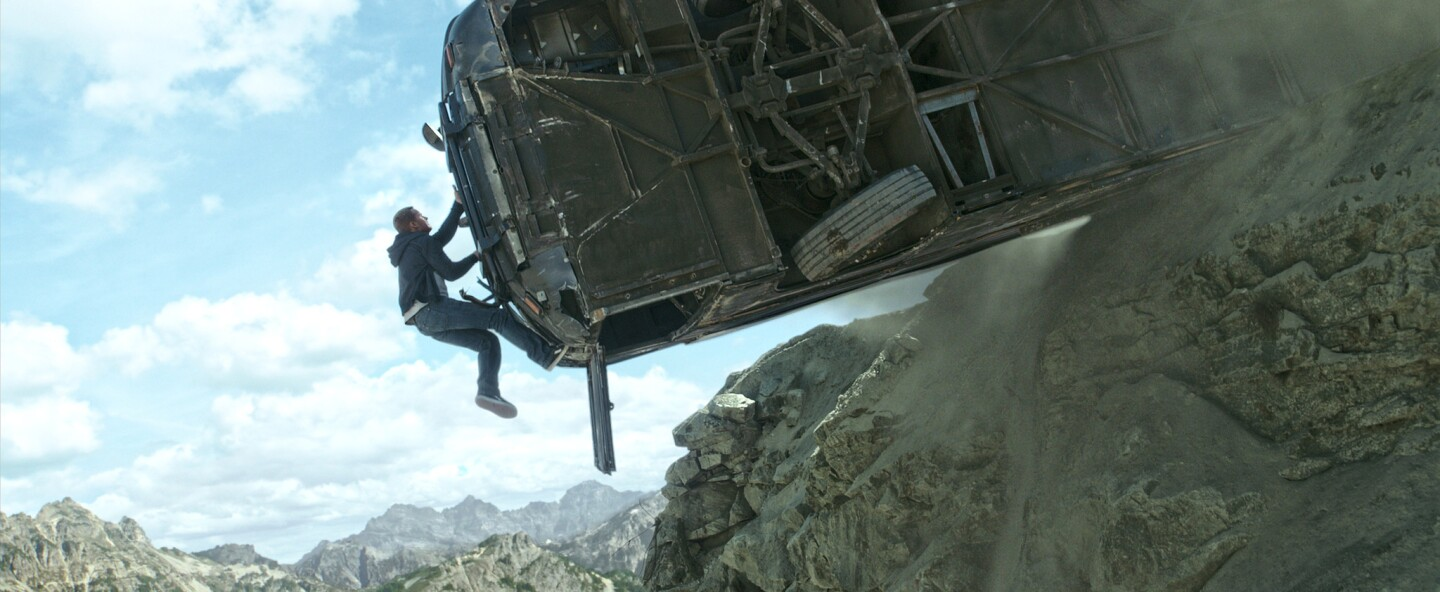 """Paul Walker scales machine and mountain in """"Furious 7."""""""