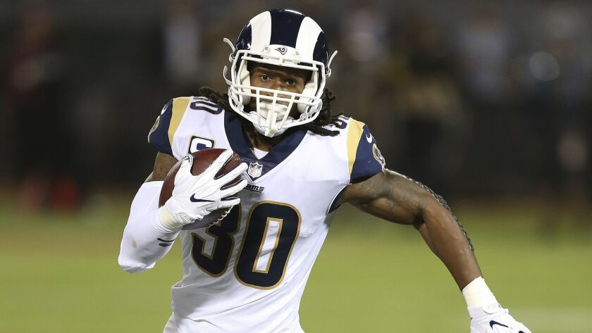 Los Angeles Rams running back Todd Gurley runs with the ball during an NFL football game against the