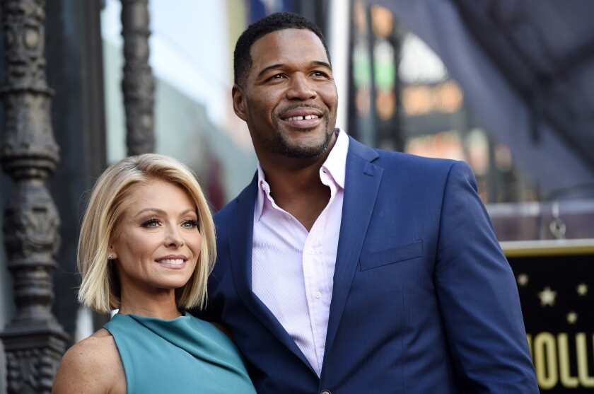 Kelly Ripa and Michael Strahan pose during an October 2015 ceremony honoring Ripa with a star on the Hollywood Walk of Fame in Los Angeles.