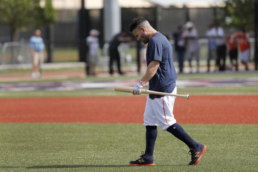 Astros second baseman Jose Altuve heads across the field before practice Feb. 13, 2020, in West Palm Beach, Fla.