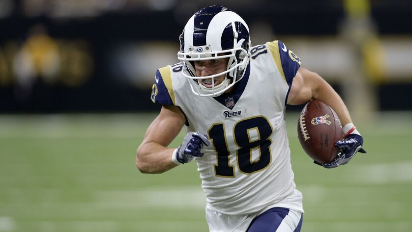 Los Angeles Rams wide receiver Cooper Kupp (18) carries for a touchdown in the second half of an NFL