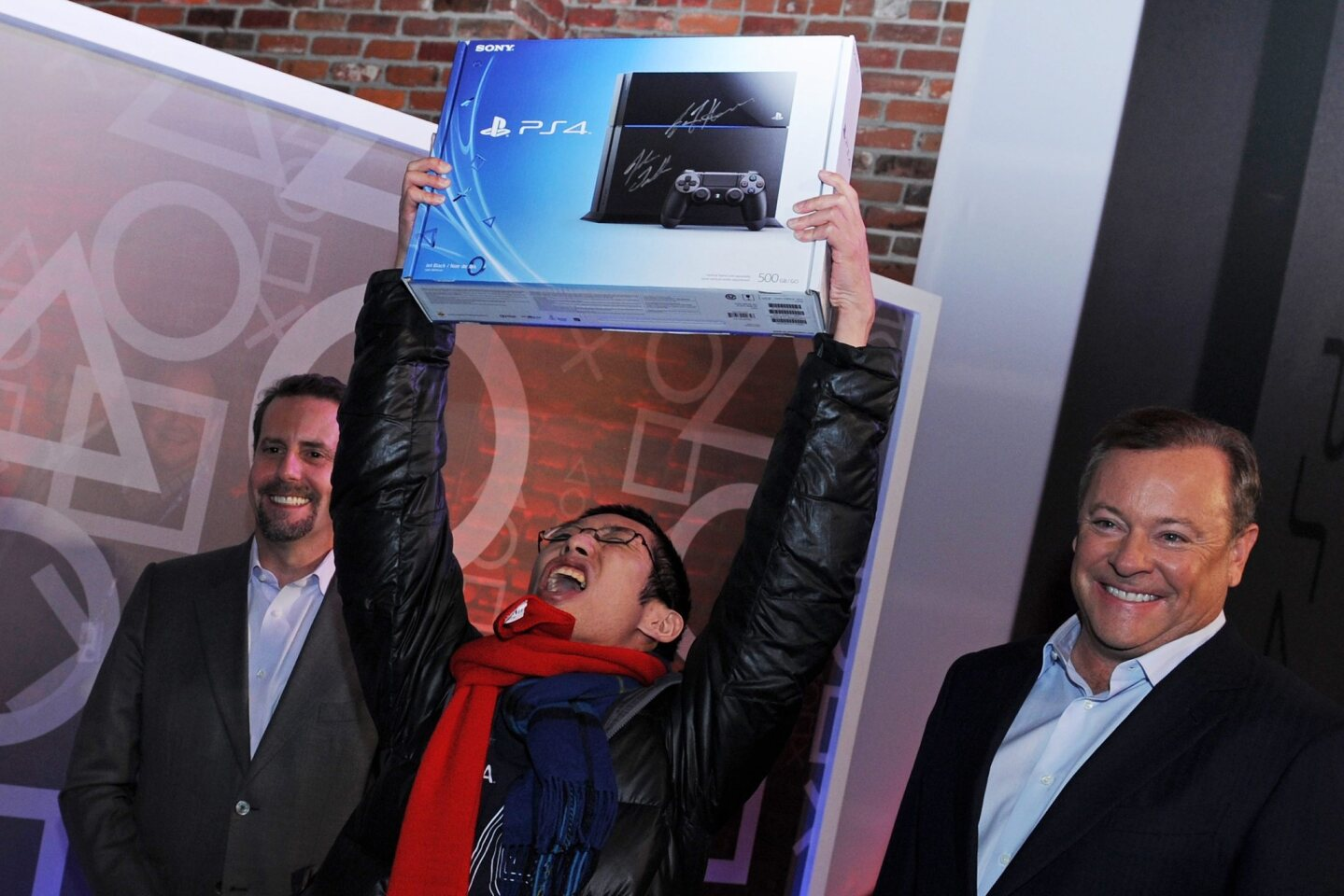 Joey Chiu, a 24-year-old from Brooklyn, is first in line to receive the new Sony PlayStation 4 during the midnight launch.