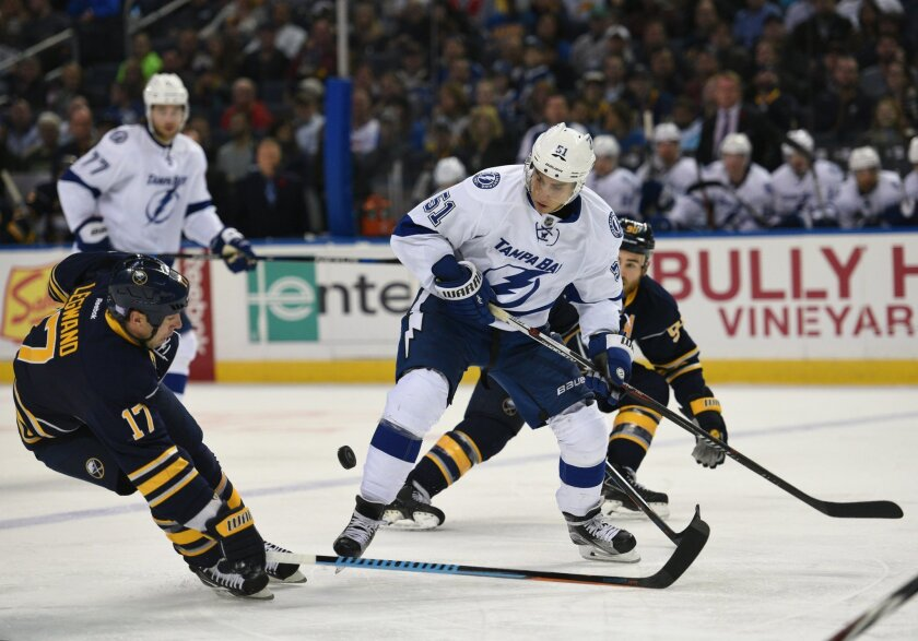 Buffalo Sabres center David Legwand (17) knocks the puck away from Tampa Bay Lightning center Valtteri Filppula (51), of Finland, during the second period of an NHL hockey game, Thursday Nov. 5, 2015, in Buffalo, N.Y. (AP Photo/Gary Wiepert)