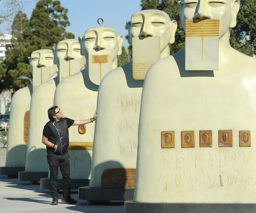 """Mexican artist Rivelino during the installation of  his monumental sculpture """"Our Silences"""" at Ruocco Park."""