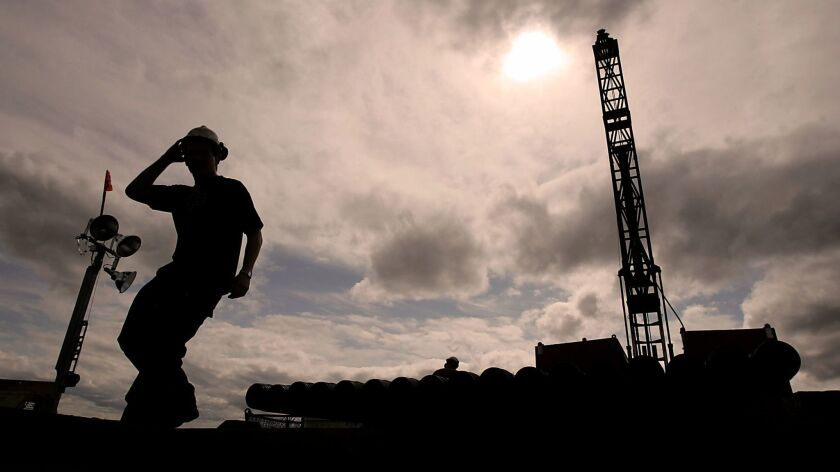 An employee of Northern Dynasty Mines Inc. mans a drilling rig in the Pebble Mine East site near the village of Iliamna, Alaska on June 6, 2007.