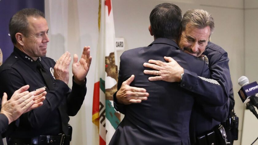 LOS ANGELES, CA - JANUARY 19, 2018: LAPD Chief Charlie Beck and Mayor Eric Garcetti hugged as the pa