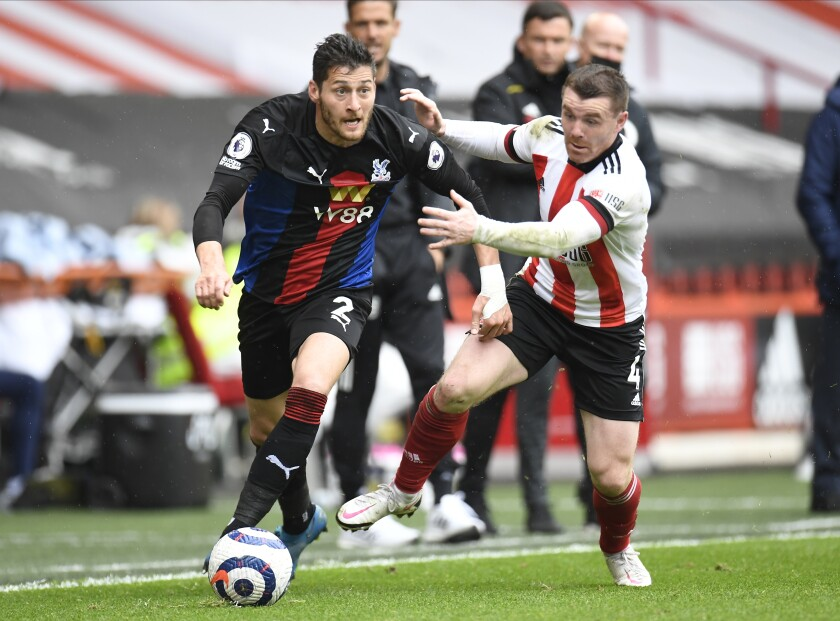 Crystal Palace's Joel Ward, left, and Sheffield United's John Fleck challenge for the ball during the English Premier League soccer match between Sheffield United and Crystal Palace at Bramall Lane in Sheffield, England, Saturday, May 8, 2021. (AP Photo/Peter Powell, Pool)