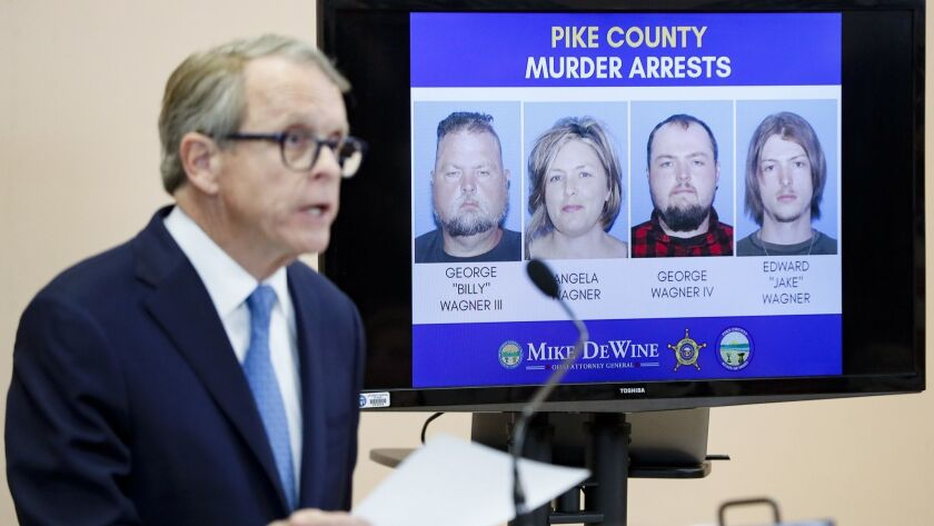Ohio Atty. Gen. Mike DeWine speaks alongside a display of those arrested during a news conference on Tuesday, in Waverly, Ohio.