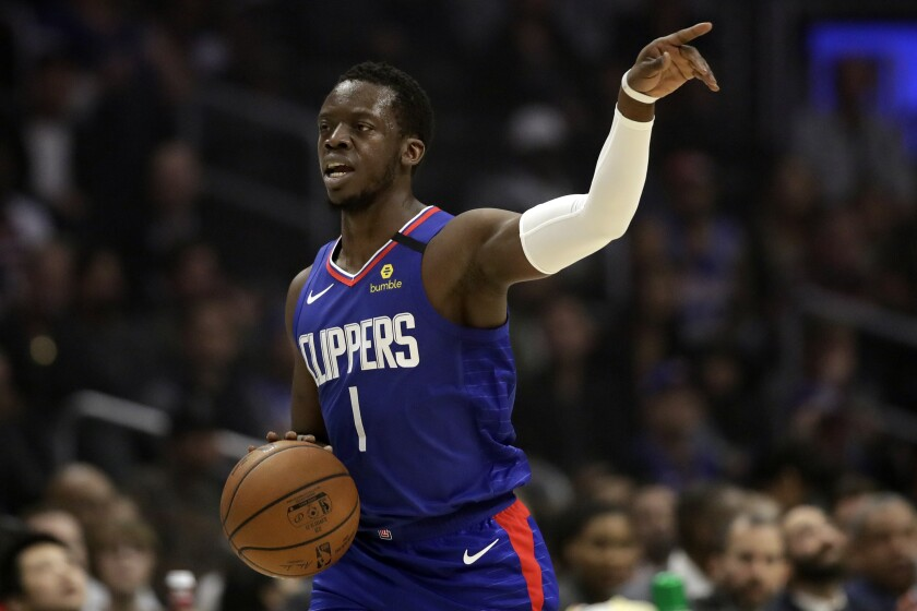 Clippers' Reggie Jackson in action against the Sacramento Kings during the first half on Saturday at Staples Center.