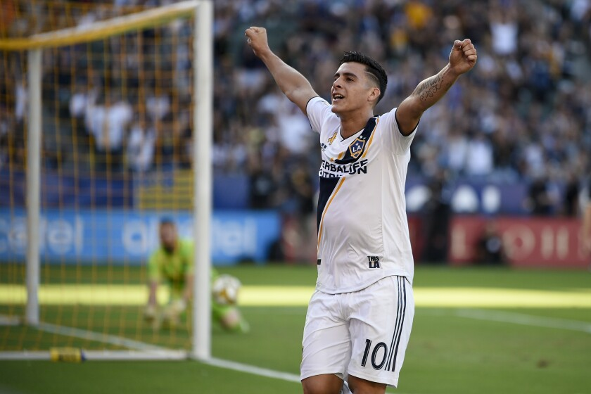 Galaxy defender Cristian Pavón (10) celebrates after assisting on a goal by Zlatan Ibrahimovic during the first half Sunday.
