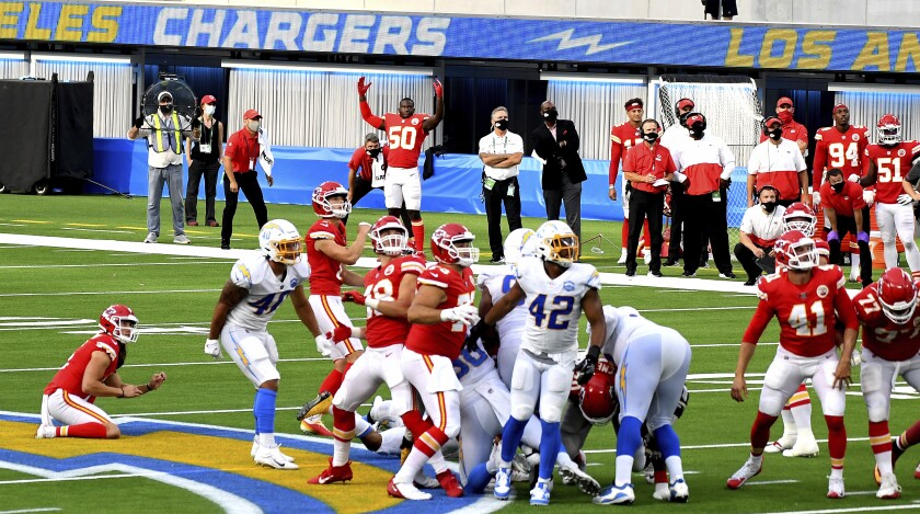 Kicker Harrison Butker, 7, of the Kansas City Chiefs kicks the winning field goal in overtime as the Kansas City Chiefs defeated the Los Angeles Chargers 23-20 during an NFL football game at SoFi Stadium in Inglewood, Calif., on Sunday, Sept. 20, 2020. (Keith Birmingham/The Orange County Register via AP)