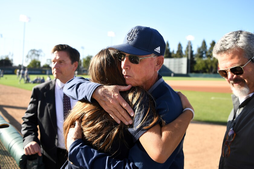UC Irvine baseball coach Mike Gillespie hugs a family member before a 2018 game