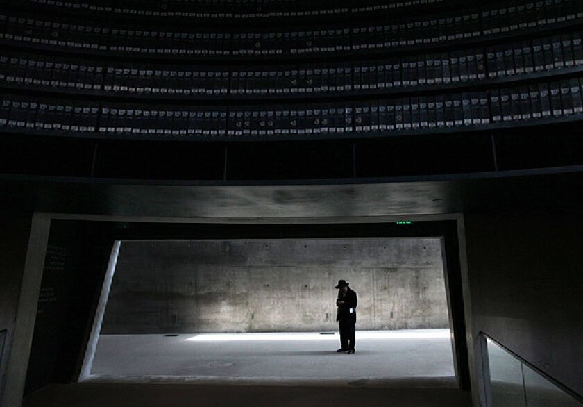 A man pauses inside the Yad Vashem Holocaust memorial museum in Jerusalem.
