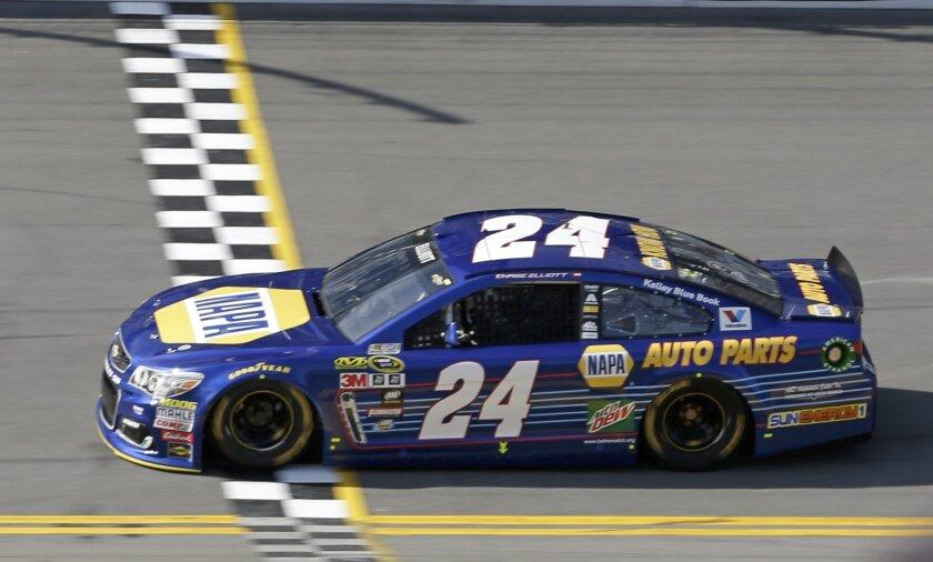 Chase Elliott crosses the finish line to qualify for the pole position in the NASCAR Daytona 500 auto race at Daytona International Speedway, Sunday, Feb. 14, 2016, in Daytona Beach, Fla. (AP Photo/John Raoux)