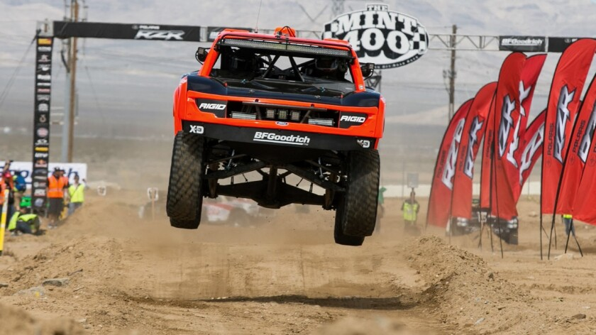 A 4x4 goes airborne at the start of the 2016 Mint 400 near Primm, Nev.