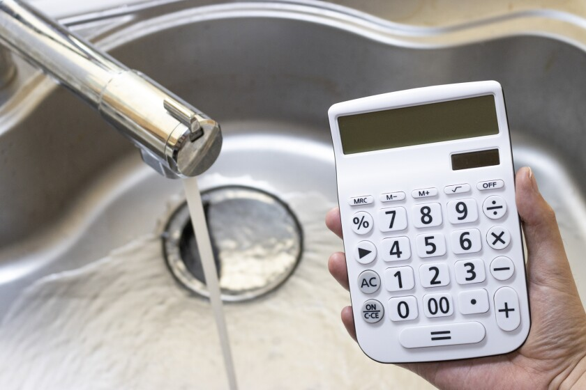 kitchen faucet with running water and calculator