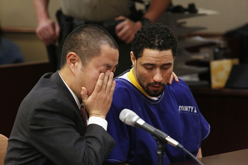 Alex Donald Jackson, right, reacts with his defense attorney Al Kim as Jackson's brother pleads for leniency during his sentencing for the second degree murder of Pamela Devitt. Jackson's pit bulls mauled to death 63-year-old Pamela Devitt in May 2013.