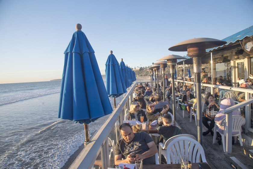 The outdoor seating area of the waterside Fisherman's Restaurant and Bar.