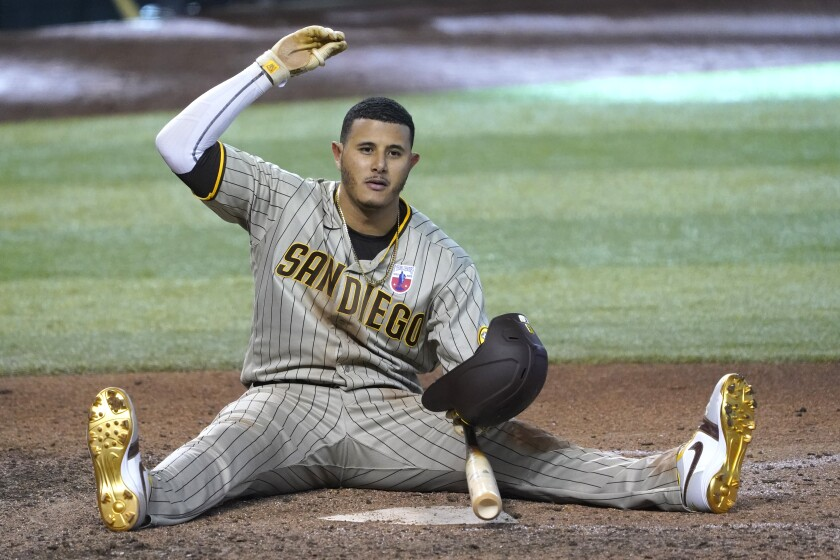 Padres' Manny Machado reacts after almost getting hit with a pitch Sunday in Phoenix.