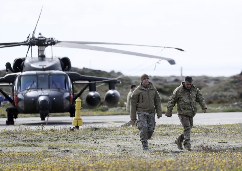 A Chilean army rescue team prepares prior their departure to search for a missing C-130 Hercules transport plane, at the air base in Punta Arenas, Chile, Wednesday, Dec. 11, 2019. Searchers using planes, ships and satellites were combing the Drake Passage on Tuesday, hunting for the plane carrying 38 people that vanished en route to an Antartica base. (AP Photo/Fernando Llano)