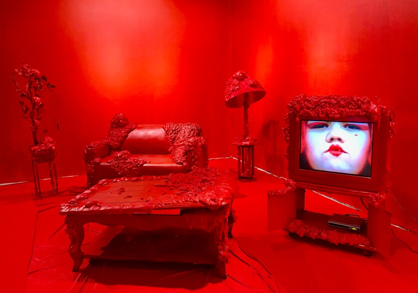 An installation view of Gabriela Ruiz's all-red room at the Little Tokyo Arts Complex.