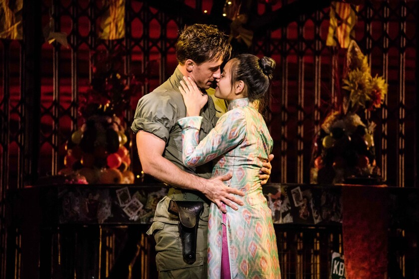 "Anthony Festa as Chris and Emily Bautista as Kim in the North American tour of ""Miss Saigon."""