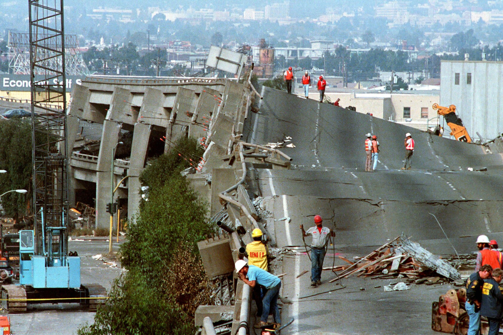 Workers check the damage to Interstate 880 in Oakland after it collapsed during the Loma Prieta earthqakes. (image)