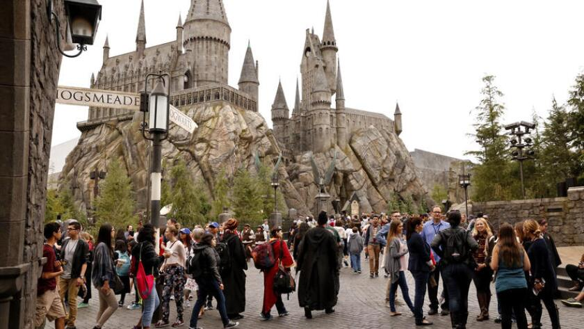 Visitors walk around the Wizarding World of Harry Potter attraction at Universal Studios Hollywood.