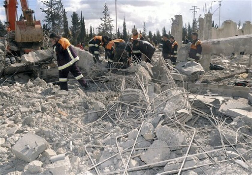 In this photo released by the Syrian official news agency SANA, Syrian rescue workers remove wreckage from a destroyed building at a security compound which was attacked by an explosion, in the northern city of Aleppo, Syria, on Friday Feb. 10, 2012. Two explosions targeted security compounds in the northern Syrian city of Aleppo on Friday, state media said, causing an unspecified number of casualties in a major city seen as key to President Bashar Assad's grip on power. (AP Photo/SANA)