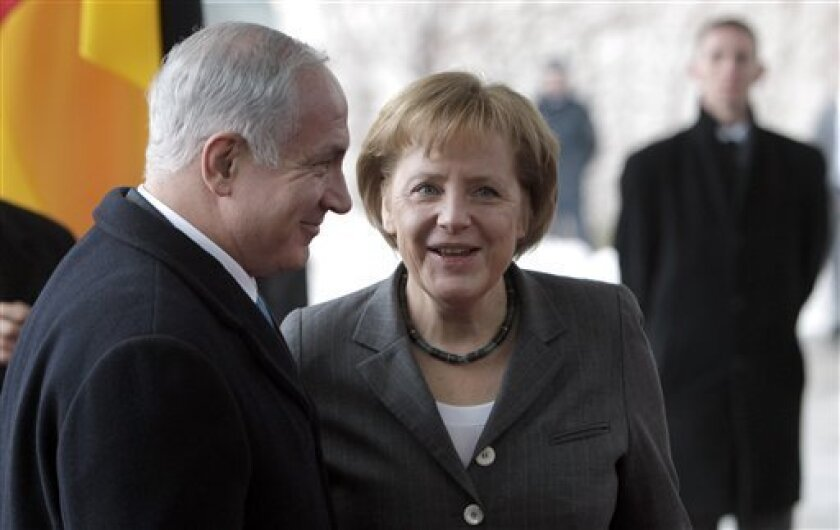 German Chancellor Angela Merkel, right, welcomes Israeli Prime Minister Benjamin Netanyahu, left, for a meeting at the chancellery in Berlin, Germany, Monday, Jan. 18, 2010. Israel's government convened for the first time in Berlin, the former heart of the Nazi regime, for a special joint session w