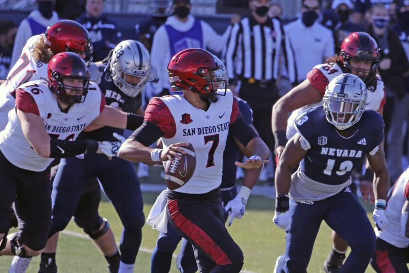 San Diego State quarterback Lucas Johnson looks to throw against Nevada.