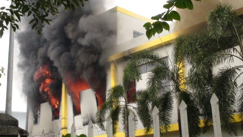 Smoke and flames billow from a factory window in Binh Duong, Vietnam after anti-China protesters set more than a dozen factories on fire.