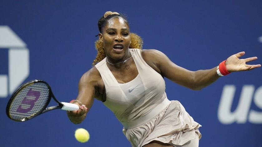 Serena Williams returns a shot during her loss to Victoria Azarenka.