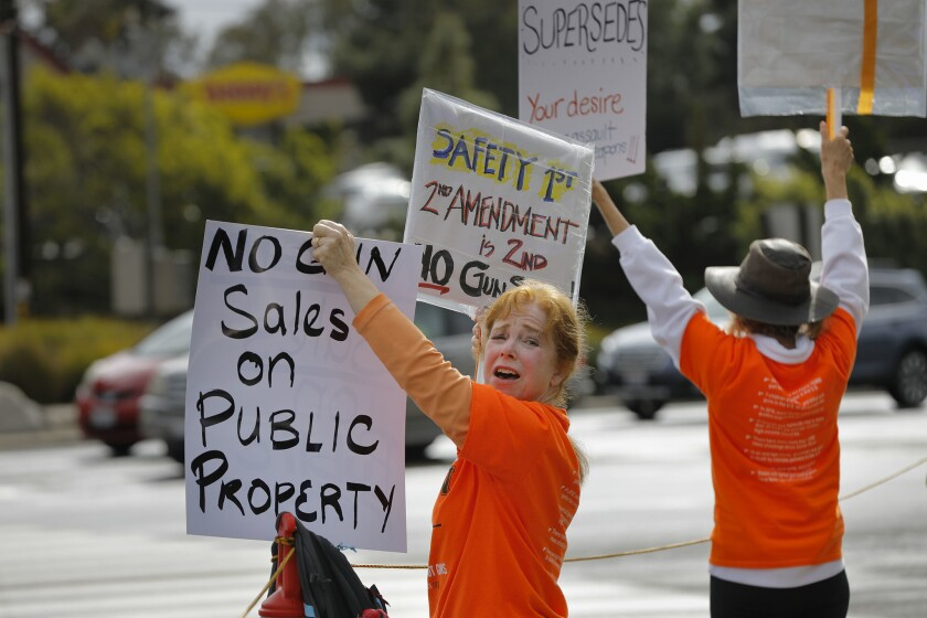 Adele Josepho of Solana Beach was one of about 80 people from NeverAgainCA who protested outside the Crossroads of the West gun show at Del Mar in 2018.