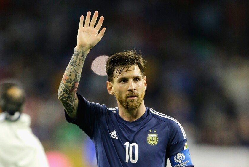 Argentina's Lionel Messi waves to the crowd after his team defeated the United States, 4-0, in a Copa America semifinal match.