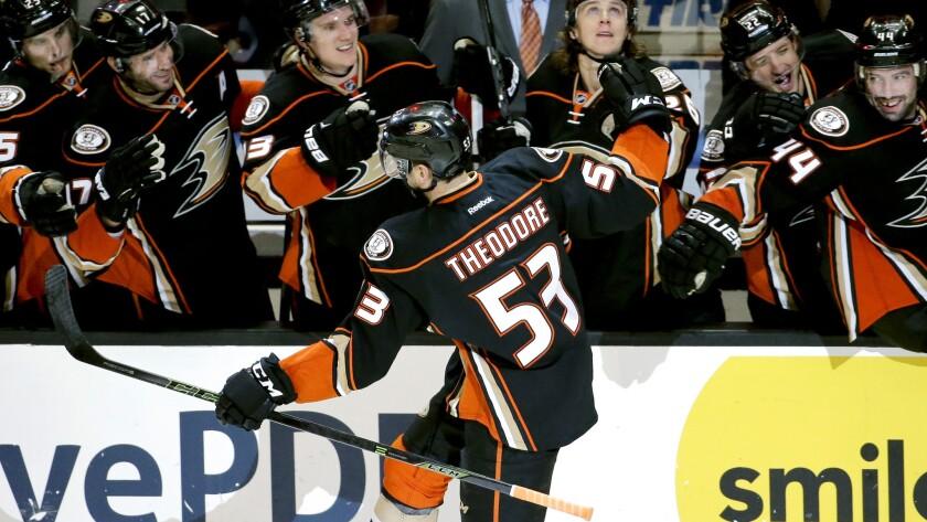 Ducks defenseman Shea Theodore celebrates with teammates after scoring against the Ottawa Senators at Honda Center in Anaheim on Jan. 13.