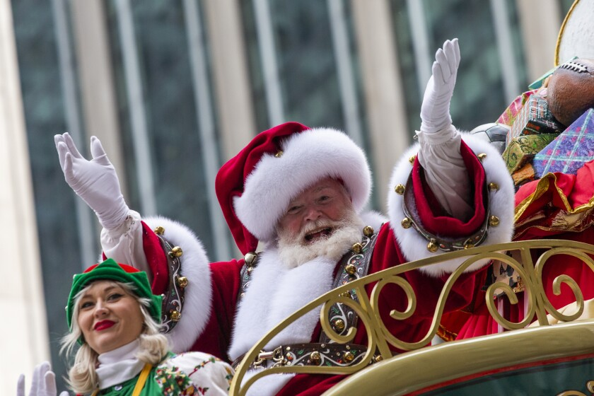 Santa Claus waves during the Macy's Thanksgiving Day Parade in 2019.