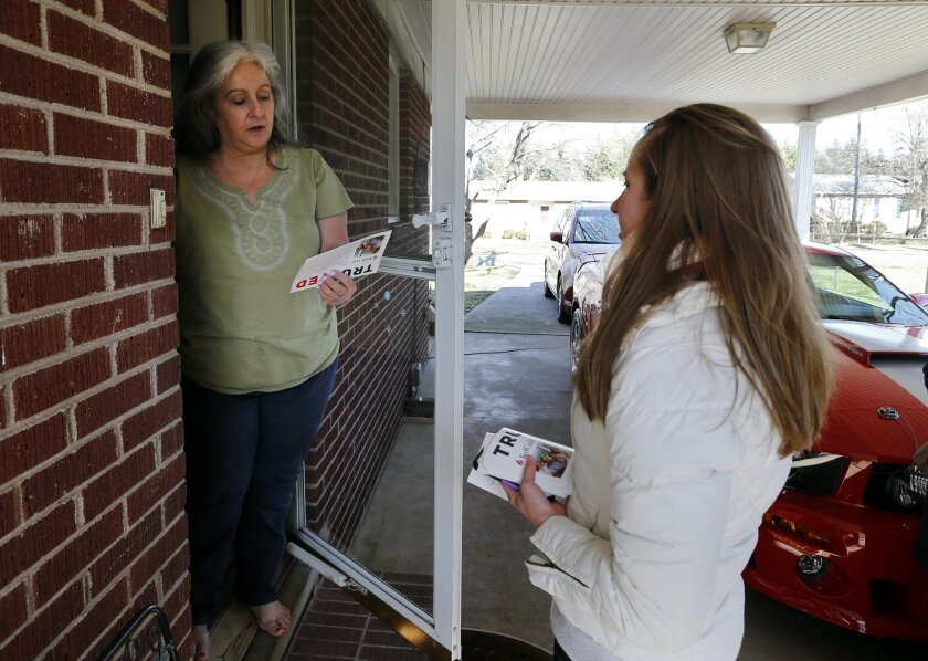 Volunteer Beth Avery, right, of Gambrills, Md., speaks with Denise Mahon, while campaigning for Republican presidential candidate Sen. Ted Cruz, R-Texas, Tuesday, Feb. 16, 2016, in Greenville, S.C. For months, Cruz's campaign has touted an expensive and sophisticated get-out-the-vote operation as i