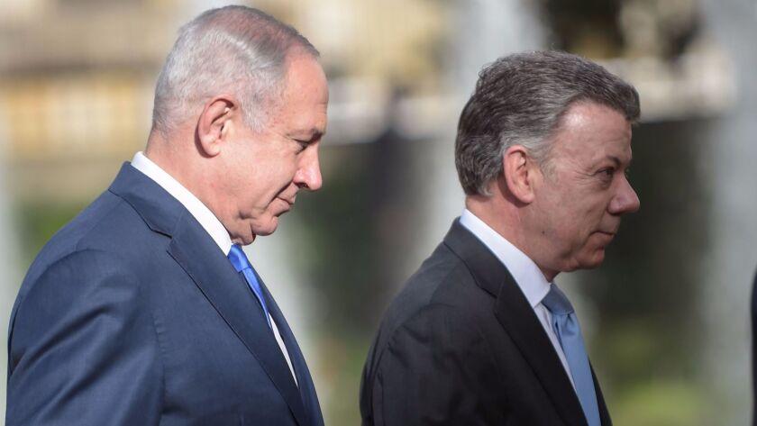 Israeli Prime Minister Benjamin Netanyahu, left, and Colombian President Juan Manuel Santos attend a
