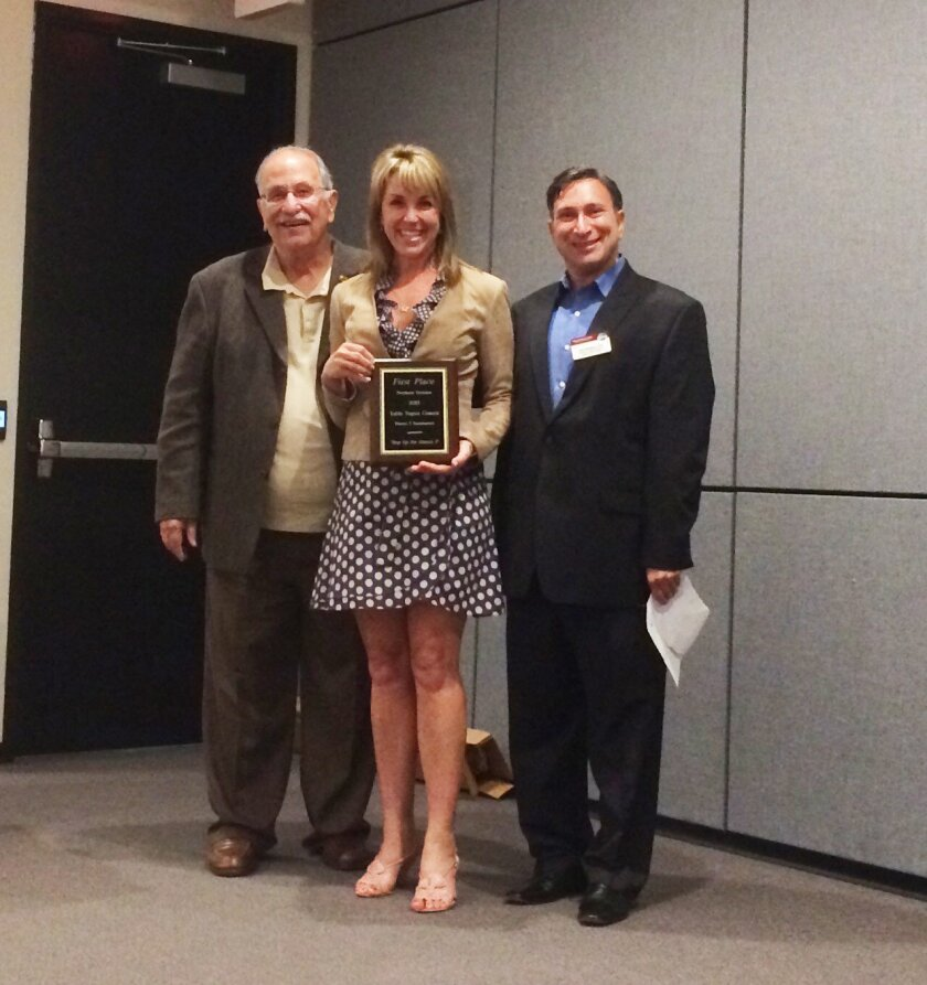 RSF Toastmasters congratulate member Terri Ensor, pictured in center.