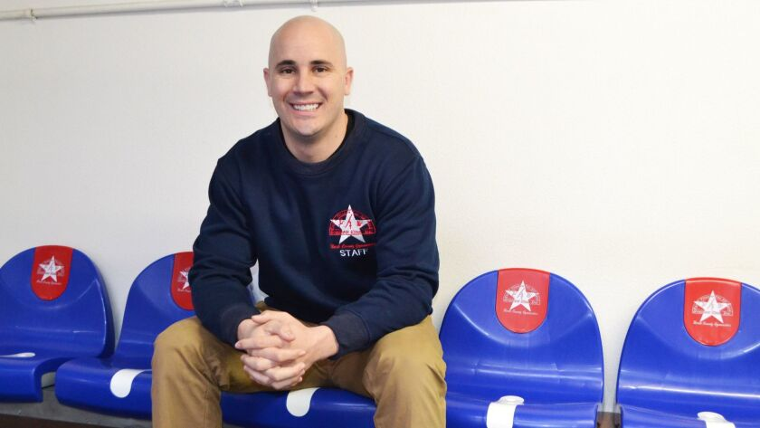 Director of Operations Daniel Grundert in the new seating for parents on the gymnasium's second floo