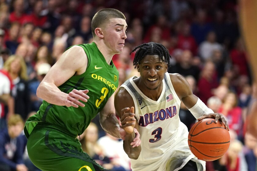 Arizona's Dylan Smith drives on Oregon's Payton Pritchard on Feb. 22, 2020.