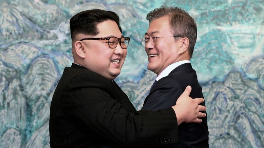 North Korean leader Kim Jong Un, left, and South Korean President Moon Jae-in embrace on April 27, 2018, after meeting at the border village of Panmunjom.