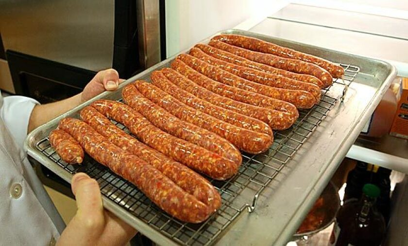 Homemade sausages get some chilling time.
