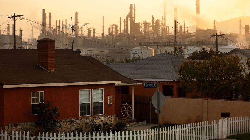 The Phillips 66 refinery looms over a Wilmington neighborhood.