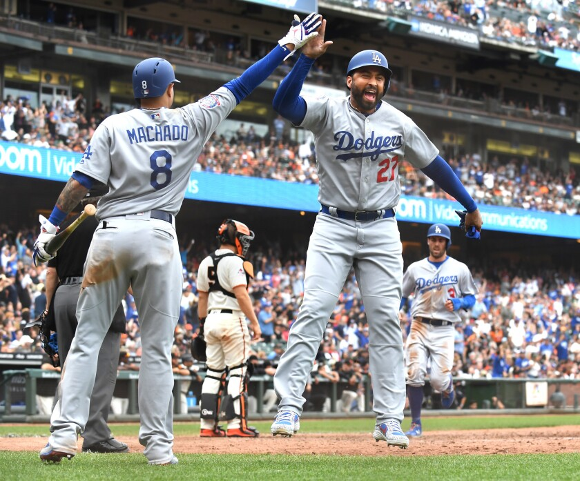 SAN FRANCISCO, SEPTEMBER 29, 2018-Dodgers Matt Kemp (27) celebrates with Manny Machado after scoring